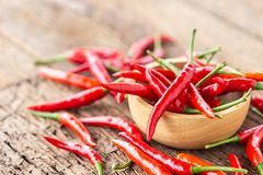 Fresh red hot chilli on wooden table background. stock photo