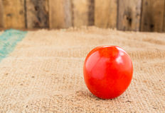 Close up Fresh red tomato on grunged  sack background Royalty Free Stock Photography