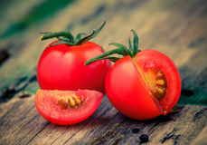 Close-up of fresh, ripe cherry tomatoes on wood Royalty Free Stock Photos
