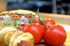 Close-up of fresh, ripe cherry tomatoes on wood . Royalty Free Stock Photos