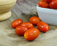 Close-up of fresh, ripe cherry tomatoes on wood Stock Images
