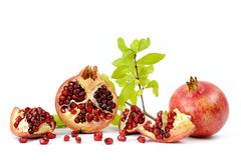 Close up of fresh ripe pomegranates royalty free stock photography