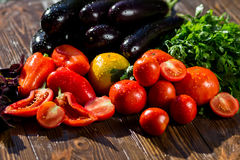 Close-up of fresh, ripe tomatoes, eggplant, sweet red pepper and Stock Images