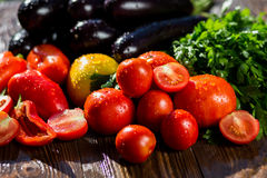 Close-up of fresh, ripe tomatoes, eggplant, sweet red pepper and Stock Photo