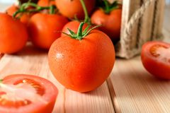 Close-up of fresh, ripe tomatoes on wooden background.  stock images