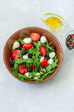 Close up of fresh salad with rucola, tomatoes cherry, olives, sp Stock Images