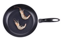 Close up of fresh shrimps on frying pan. Royalty Free Stock Images
