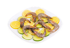 Close up of fresh shrimps with lime Royalty Free Stock Images