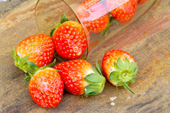 Close up of fresh strawberries on the table and inside grass on Royalty Free Stock Image