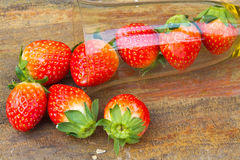 Close up of fresh strawberries on the table and inside grass on Royalty Free Stock Images