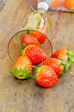 Close up of fresh strawberries on the table and inside grass on Royalty Free Stock Photography