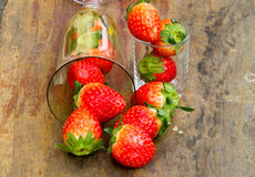 Close up of fresh strawberries on the table and inside grass on Stock Photo