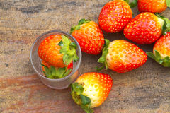 Close up of fresh strawberries on the table and inside grass on Stock Image