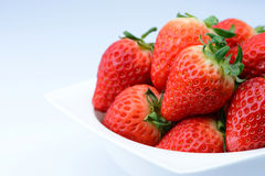 Close up fresh strawberry in white bowl with copy space Royalty Free Stock Photos