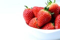 Close up fresh strawberry in white bowl isolated white backgroun Royalty Free Stock Photos