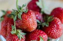 Close up of fresh sweet strawberry`s in glass royalty free stock photography