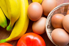 Close-up of fresh tomato, bananas and eggs Stock Photography
