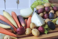 Close up of fresh vegetables for soup. Carrots, potatoes, onions, and celery - perfect and ready for fresh, healthy soup Royalty Free Stock Image
