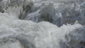 Close up of water stream with white and transparent bubbles. Close up of fresh water stream with white and transparent bubbles stock footage