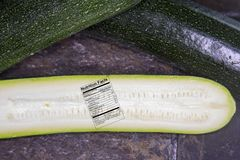 Close up of fresh zucchini or courgette slice with nutritional f Royalty Free Stock Images