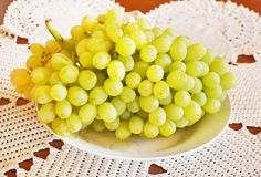 Close up of fresh yellow grapes in plate - summer fruits Royalty Free Stock Images