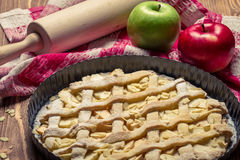 Close-up of freshly baked apple pie and fruit Stock Images