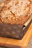 Close up of freshly baked, homemade, cranberry, pecan bread loaf in cardboard form Stock Images