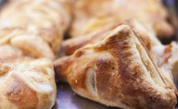 Close up freshly baked puff pasty from the oven in bakery shop royalty free stock photos