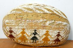 Sourdough bread decorated with hora, a Romanian traditional dance Stock Photography