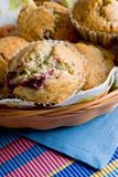 Close-up of freshly bakes cherry muffins in the basket Stock Images