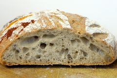 Cut sourdough bread decorated with hora, a Romanian traditional dance Royalty Free Stock Photos