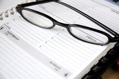 Close up friday on planner. With eye glasses Stock Photo