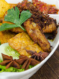 Close up fried chicken. Called Ayam Penyek. This is a popular dishes among Malaysian Stock Photo