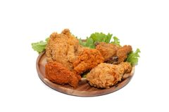 Close up of fried chickens. On wooden plate royalty free stock image