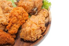 Close up of fried chickens. On wooden plate royalty free stock photo