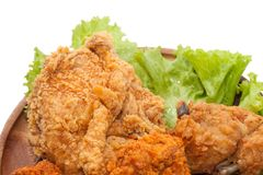Close up of fried chickens. On wooden plate stock images