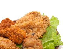 Close up of fried chickens. On wooden plate stock photo