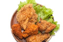 Close up of fried chickens. On wooden plate royalty free stock images