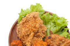 Close up of fried chickens. On wooden plate stock photography