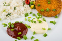 Close up of fried cutlets with rice, ketchup and mayonnaise stock image