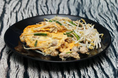 Close up,Fried egg and oyster with bean sprouts and shallot . Se. Close up, Fried oyster with bean sprouts and shallot as Hoi Tod in Thai served with chili sauce Stock Images