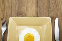 Close-up of fried egg on plate. Fried egg on plate (close-up, directly above Royalty Free Stock Photo