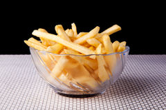 Close up Fried French Fries in glass bowl and black background. Picture of Close up Fried French Fries in glass bowl and black background Royalty Free Stock Image