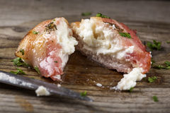 Close up of fried goat cheese wrapped in smoked bacon on wood wi Stock Photo