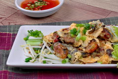 """Close up of fried oyster with bean sprouts and shallot as """"Hoi Tod"""" in Thai .  Selective focus. Fried oyster with bean sprouts and shallot as """"Hoi Tod Stock Photography"""