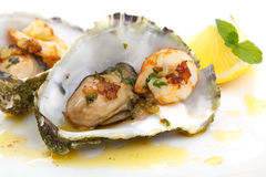 Close up of fried oysters and shrimps in a shell Royalty Free Stock Photos