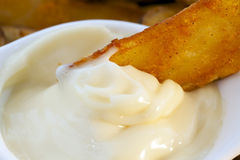 Close Up Fried Potato Dipped in Garlic Mayonnaise Royalty Free Stock Photo