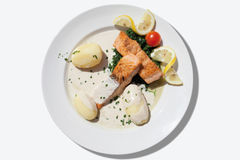 Close up of fried salmon with spinach,boiled potatoes Royalty Free Stock Images