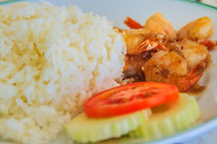 Close up fried shrimp with garlic on rice dish decorated with sl Stock Photography