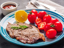 Close up fried steak and vegetables in blue plate royalty free stock photos